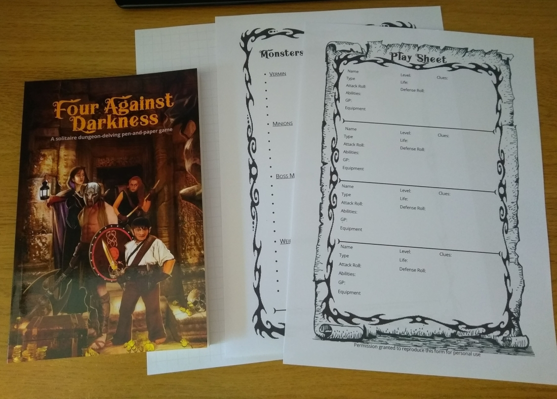 Photo of game materials - rules, character sheets, monster tracker and graph paper